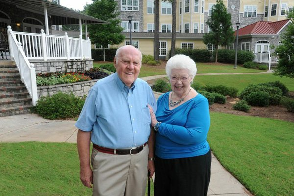Couple standing in front of villas at Park Springs
