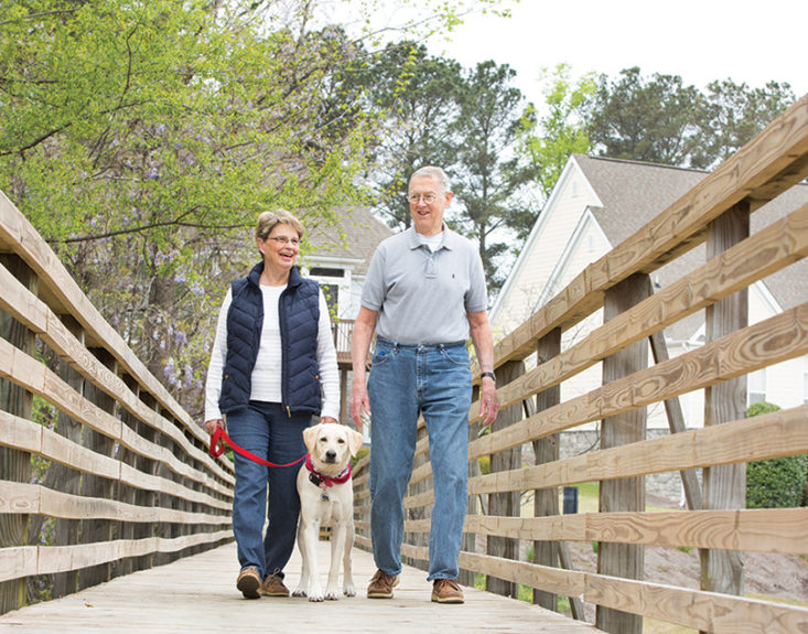 Couple-on-bridge-with-dog