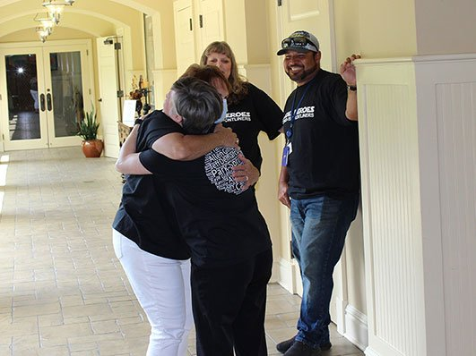 staff hugging