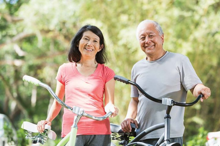 Couple-Going-For-a-Bike-Ride